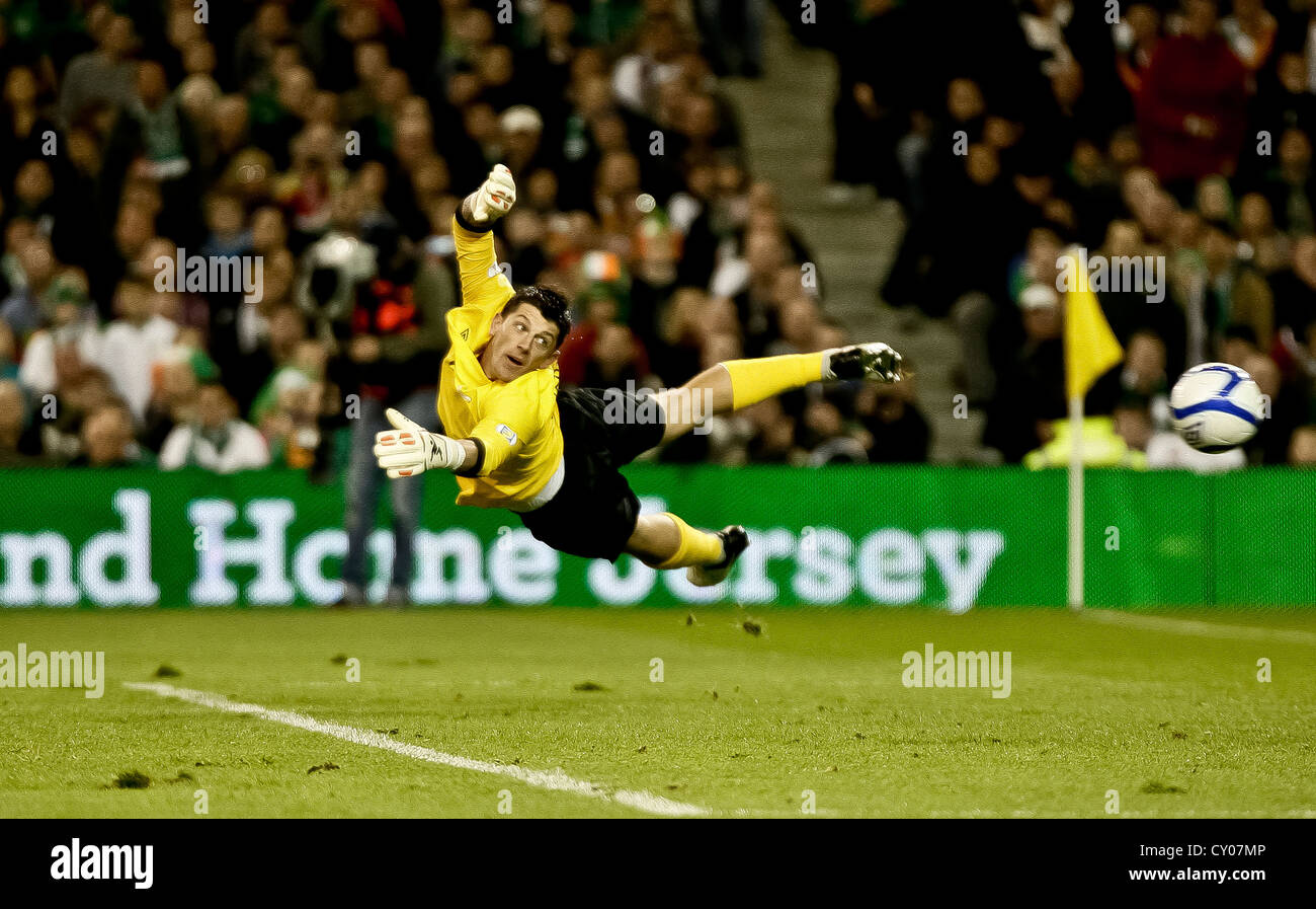 The Irish goalkeeper Keiren Westwood looks at the ball flying into the Irish net as Germany humiliated the Republic - Stock Image