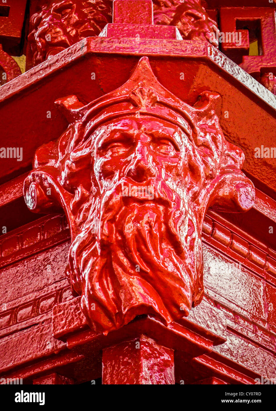 Sculpted iron head on historic docks entry in Auckland, New Zealand. - Stock Image