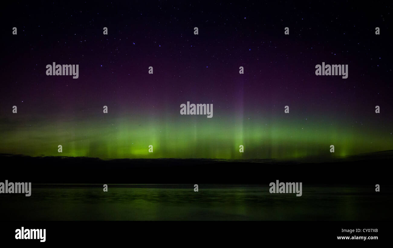 Aurora Borealis or Northern Lights seen from near  Tobermory on the Isle of Mull in the Inner Hebredes, Scotland, - Stock Image