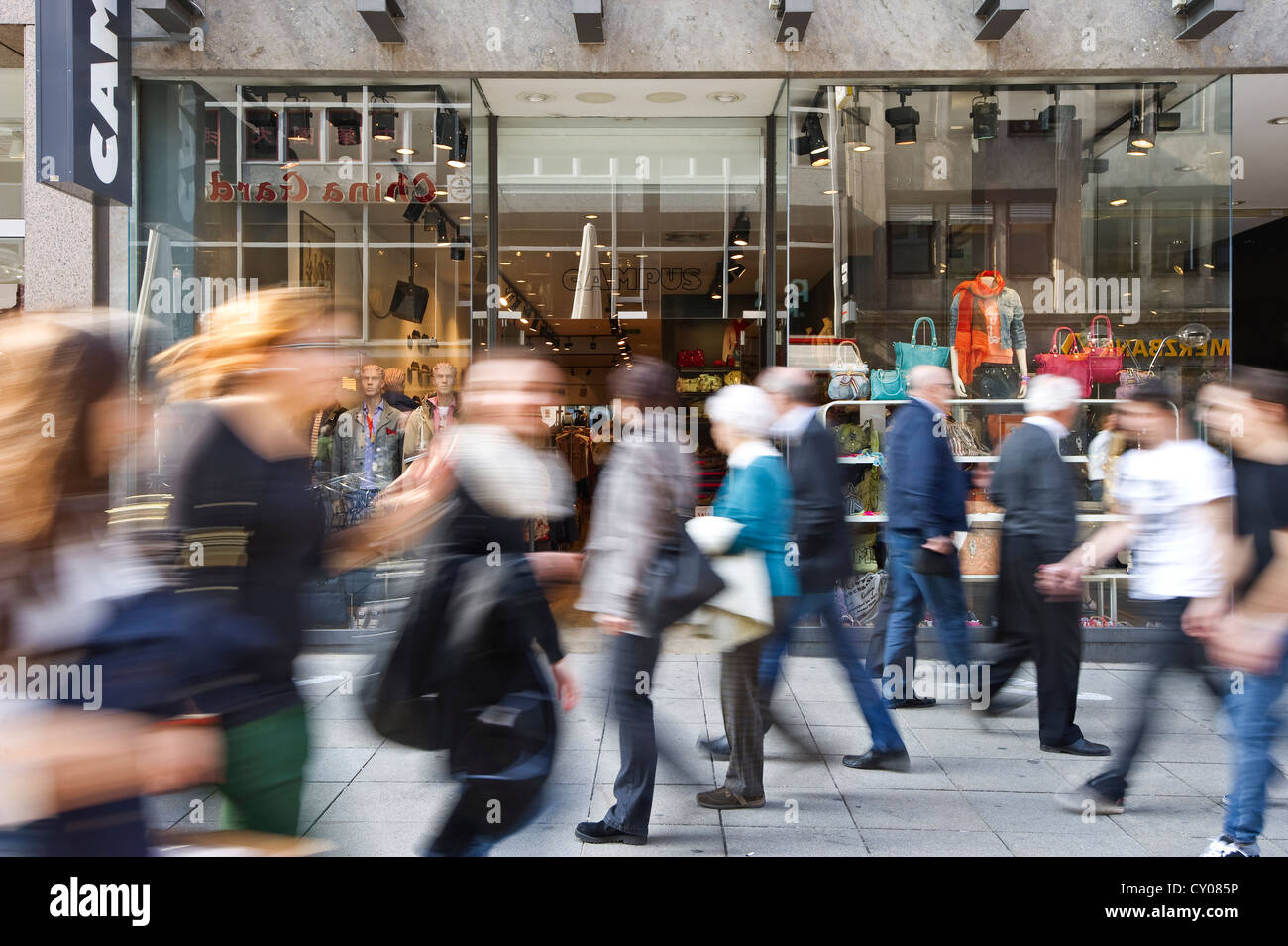 Pedestrian zone with people walking pass, motion blur, Stuttgart, Baden-Wuerttemberg - Stock Image