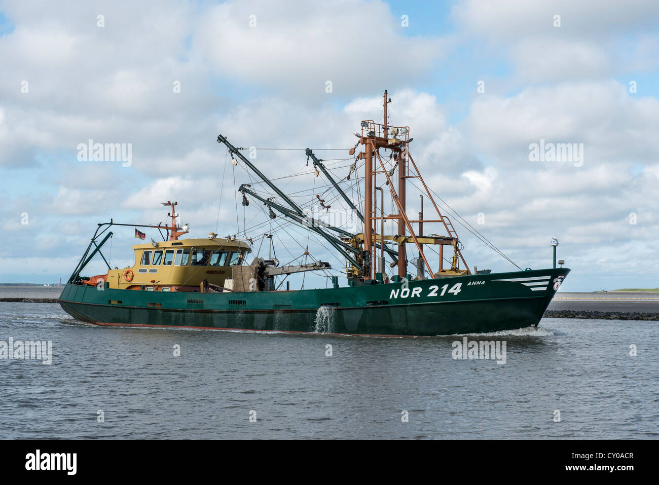 Anna NOR 214 shell cutter entering the harbour of Norddeich, East Frisia, Lower Saxony - Stock Image