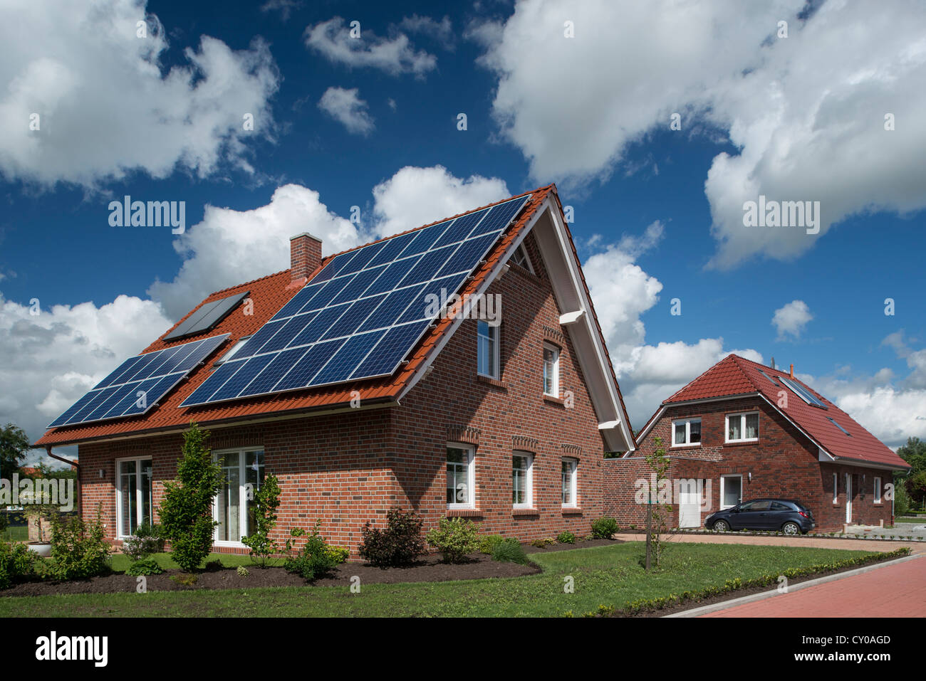 Housing development, multi-family house with solar and hot water system on the roof, solar heat, East Frisia, Lower - Stock Image