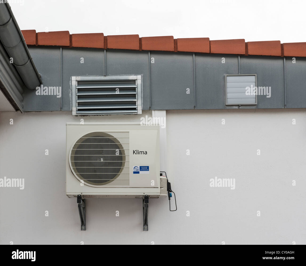 Air conditioning unit on a wall, PublicGround - Stock Image
