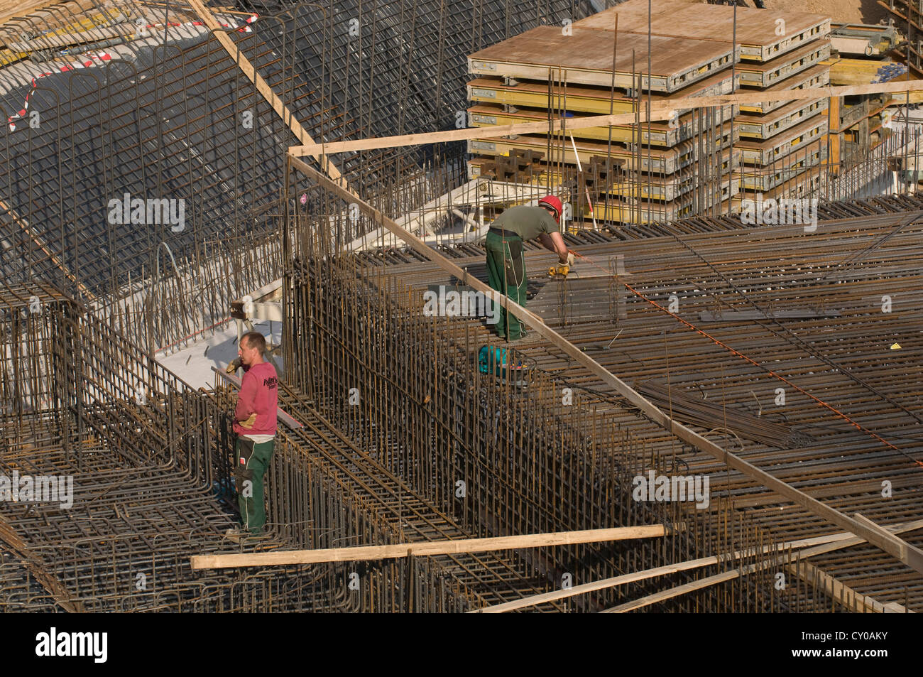 Construction workers working on the reinforcement of a building, PublicGround - Stock Image
