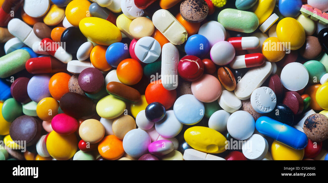 Expired medications, colourful mix of capsules, pills and tablets, full-frame - Stock Image