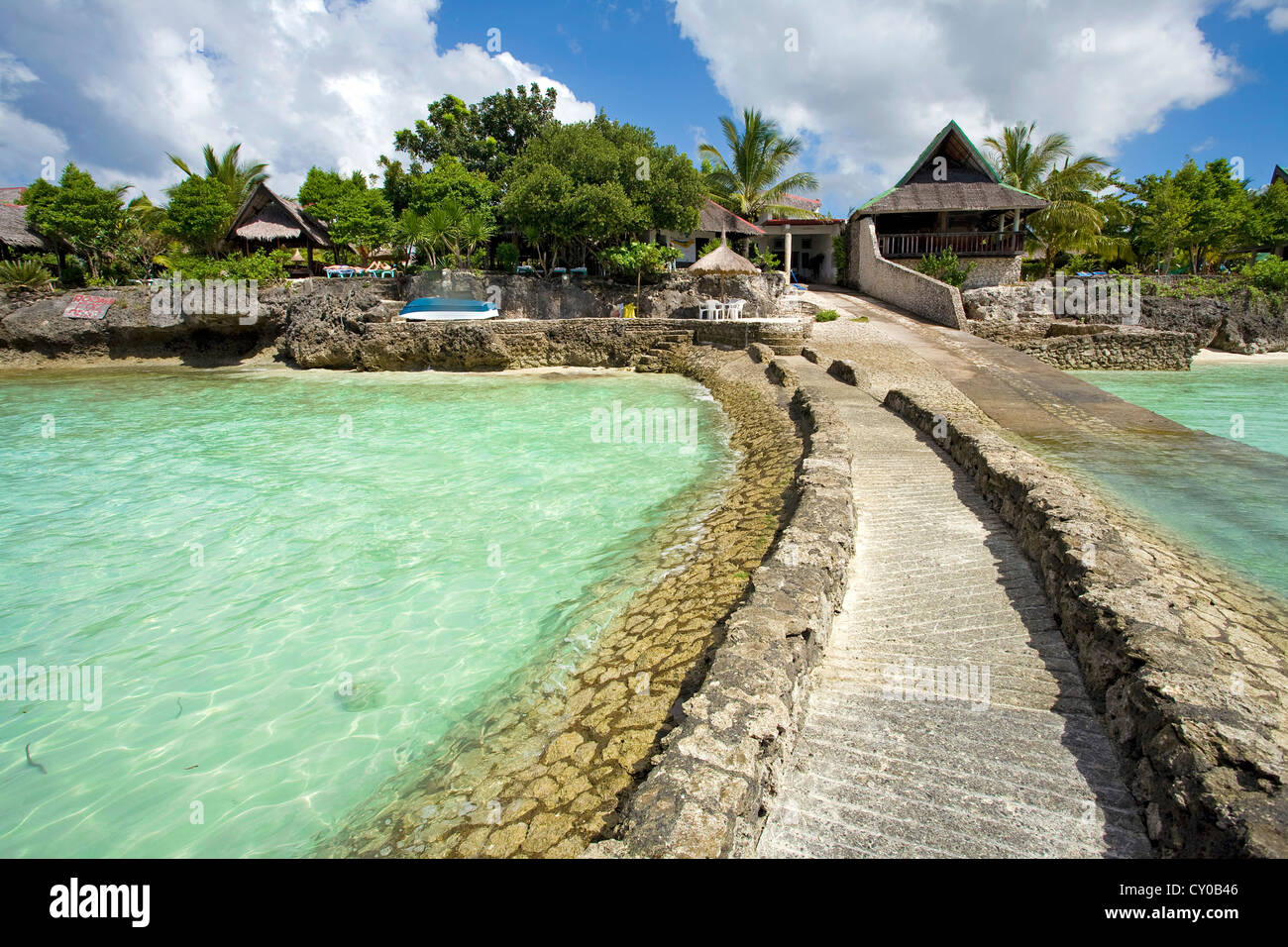 Jetty for boats, small resort, Dolphin House on White Beach, Moalboal, Cebu, Philippines, Indo-Pacific region, Asia - Stock Image