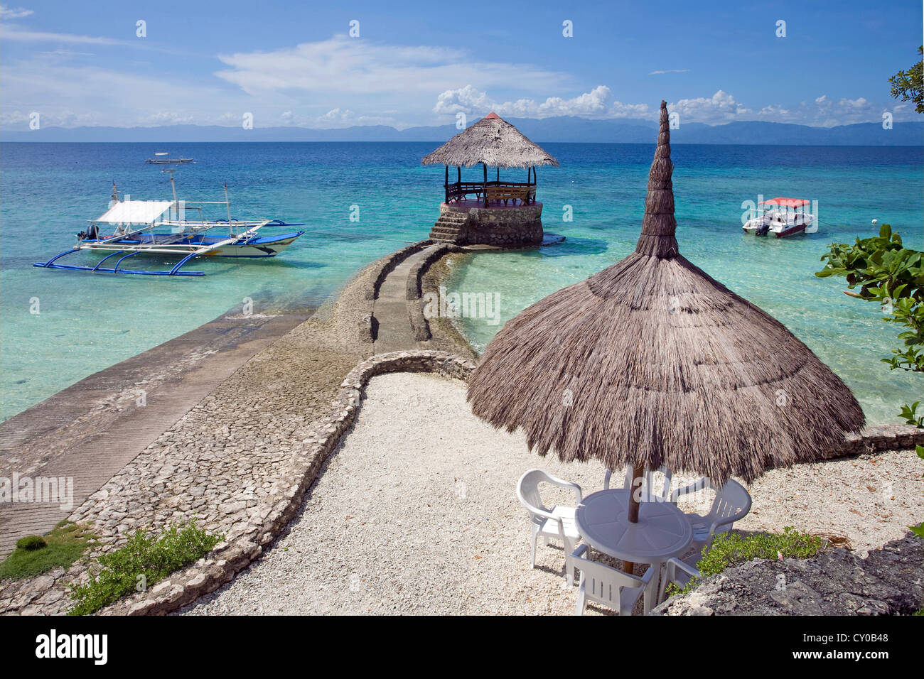 Jetty for boats, small resort, Dolphin House, on White Beach, Moalboal, Cebu, Philippines, Indo-Pacific region, - Stock Image