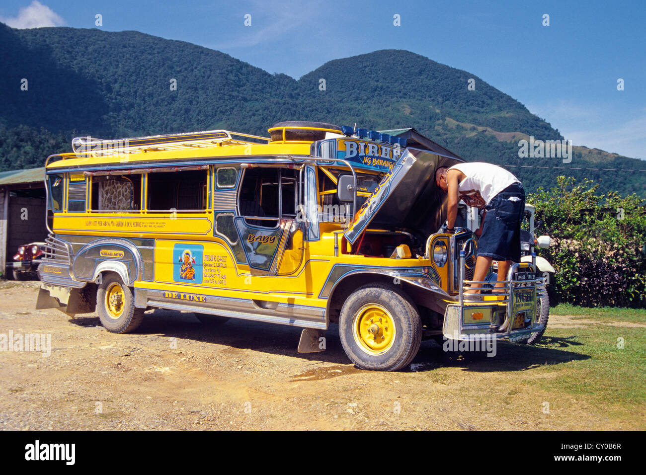 Mini-bus created from a Jeepney, one of the old jeeps left behind by the Americans when they withdrew from the Philippines - Stock Image