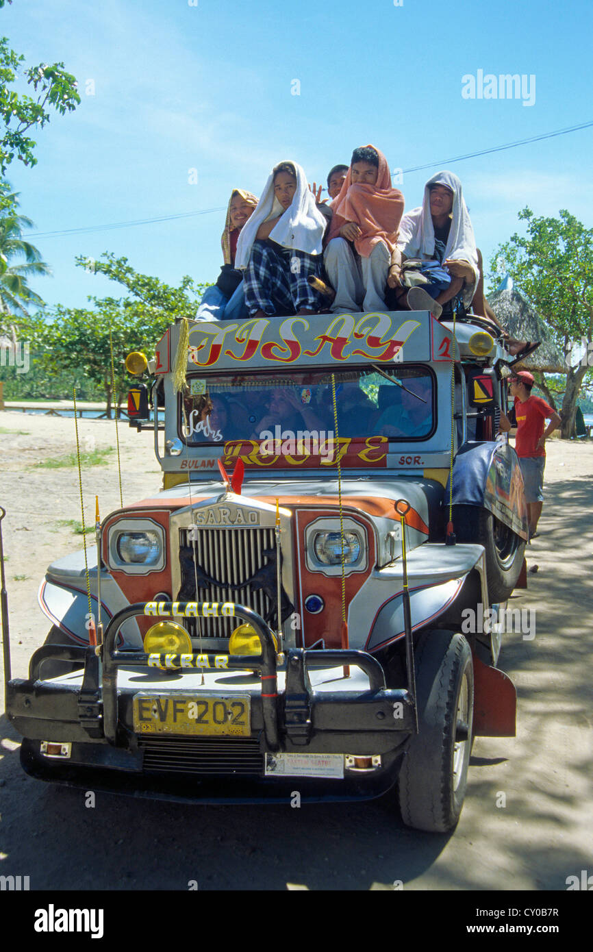 Jeepney turned into a mini-bus, one of the old jeeps that were left behind by the US-Americans after their withdrawal - Stock Image