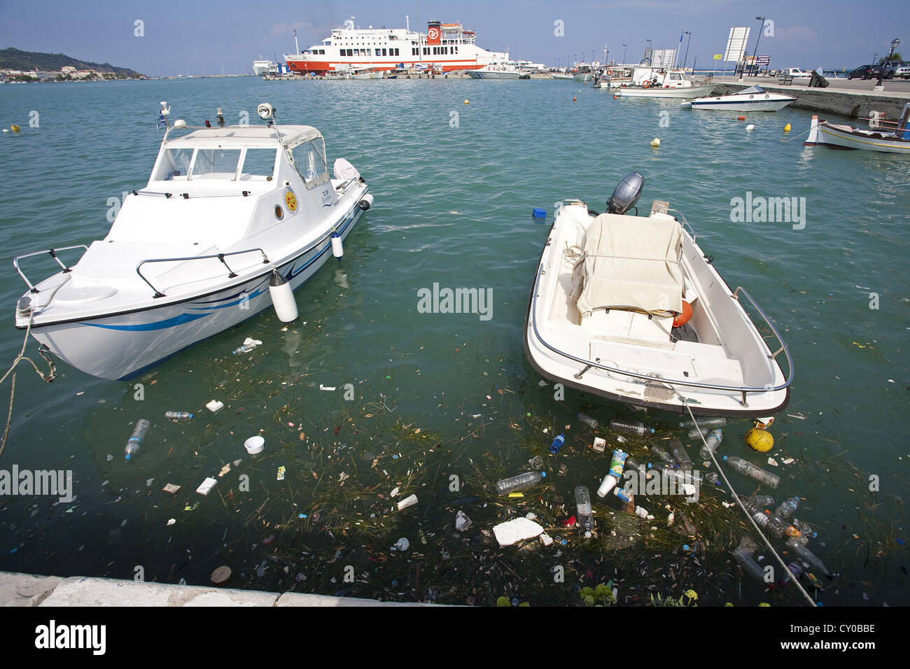 Civilisation rubbish floating in the harbour or Zakynthos town, Island of Zakynthos or Zante, Greece, Europe - Stock Image