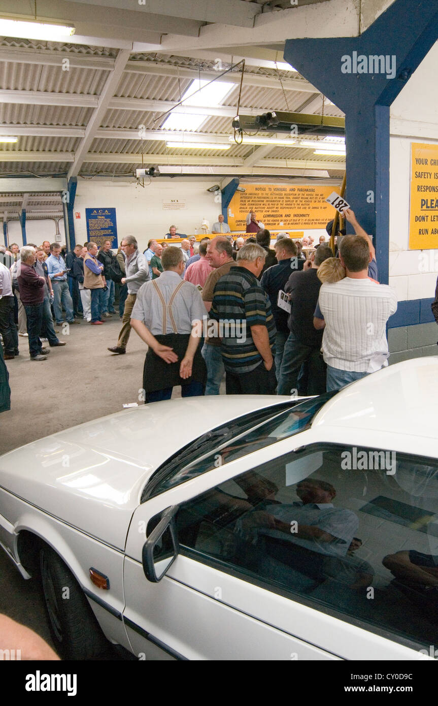car auction auctions buying old at cars selling buy sell second hand secondhand car salesman man men sales salesmen - Stock Image