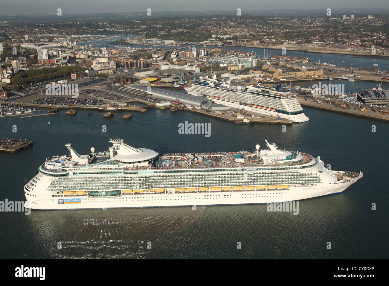 Independence Of The Seas passes Celebrity Eclipse in the port of Southampton. Aerial photos. - Stock Image