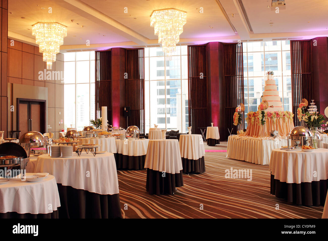 Beautiful ballroom decorated with set for a wedding party Stock Photo