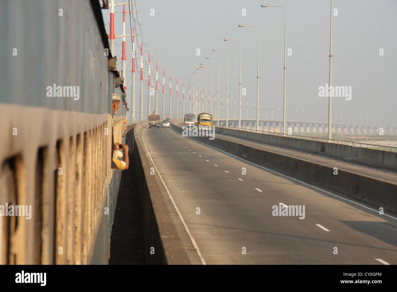 A train runs through the Bangabandhu Multipurpose Jamuna Bridge. Tangail, Bangladesh. - Stock Image