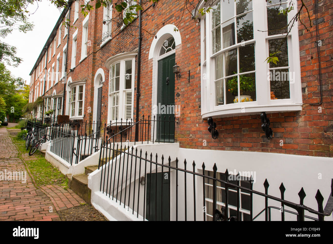 Kent Royal Tunbridge Wells Bedford Terrace typical Georgian red brick houses bay windows basements steps metal iron - Stock Image