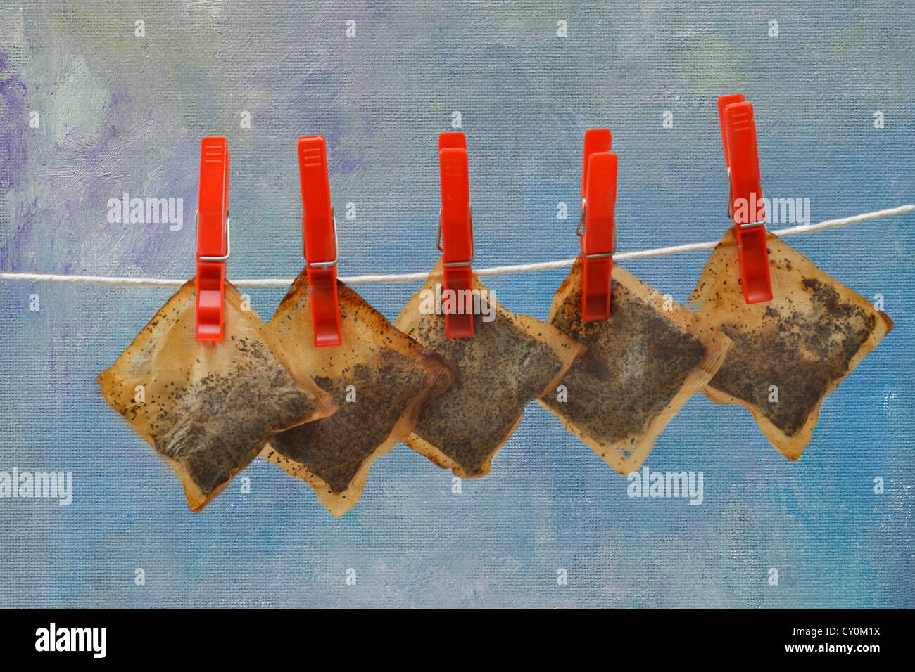 Saving money by reusing tea bags - Stock Image