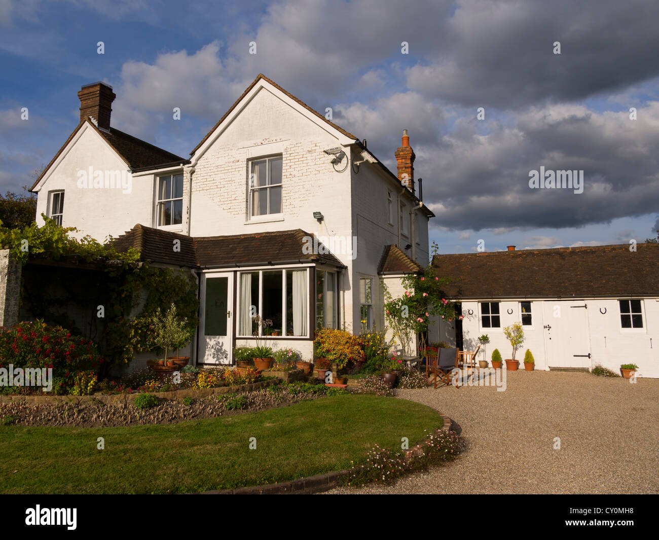 Victorian Country House In Sussex A Typical White Painted Brick With Historic Outbuildings And Pretty Garden