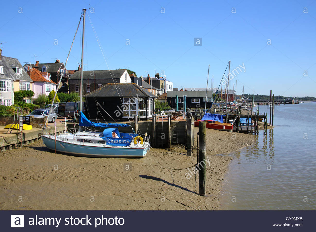 boats moored on the river colne at wivenhoe on the coast of essex - Stock Image