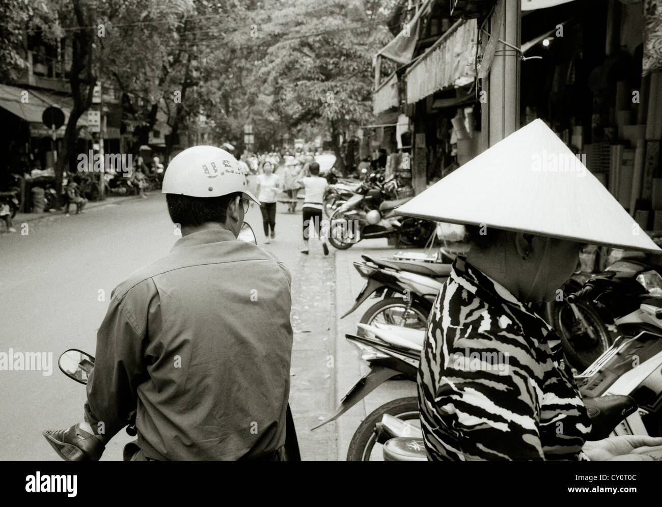 Woman in conical hat in the Old City of Hanoi in Vietnam in Far East Southeast Asia. Street Scene Life Lifestyle - Stock Image
