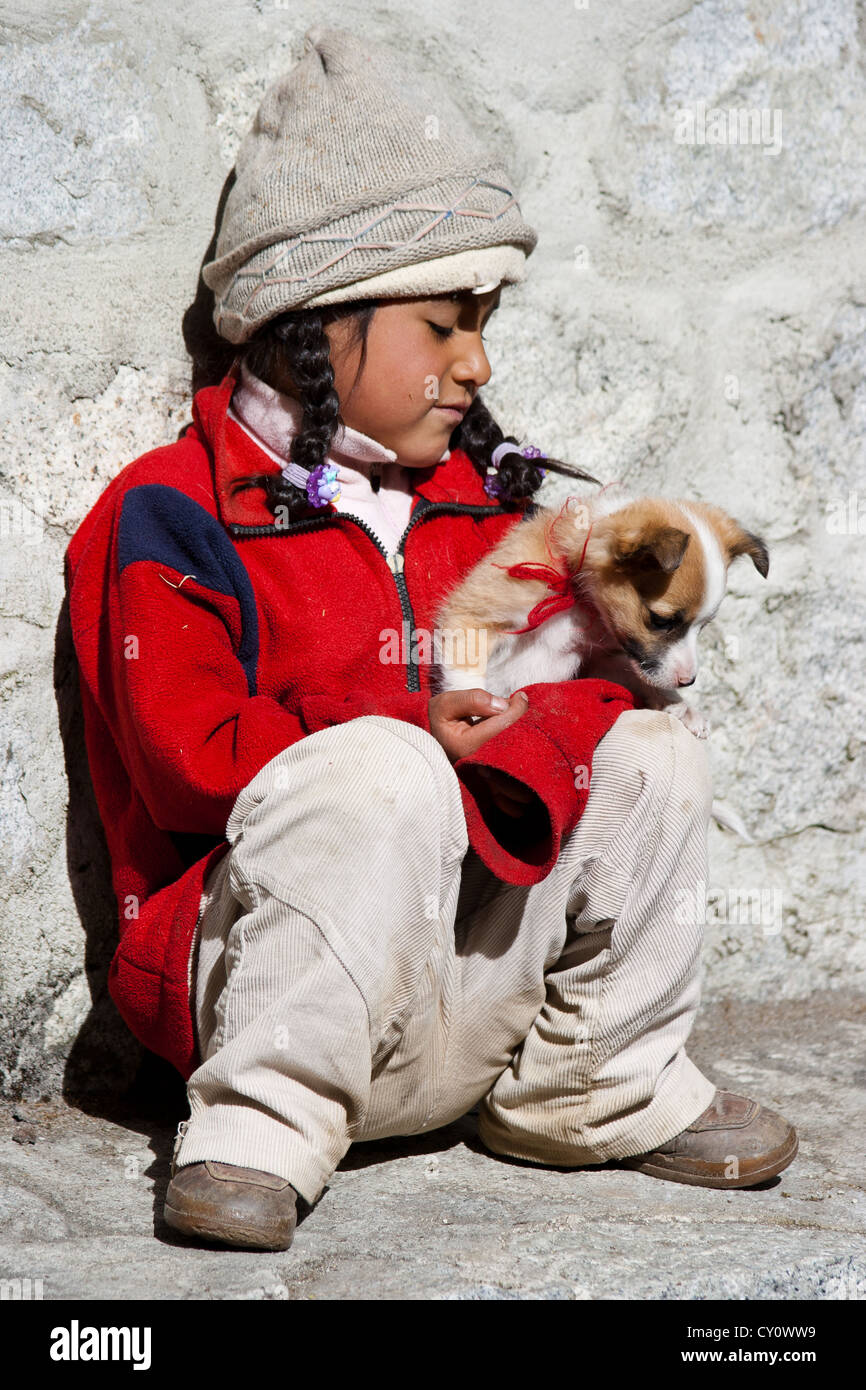 Little girl with puppy dog - Stock Image