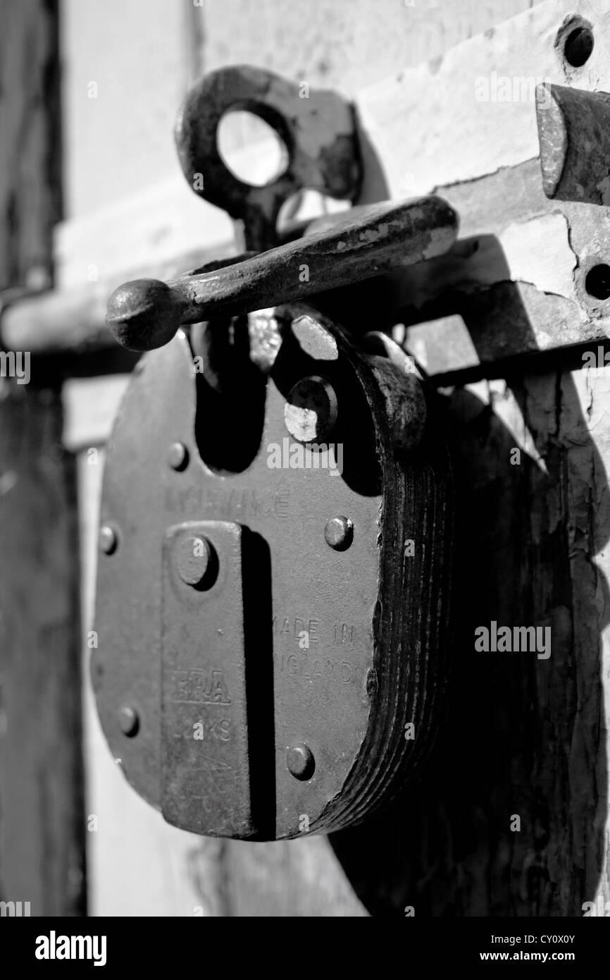 Padlocked door - Stock Image
