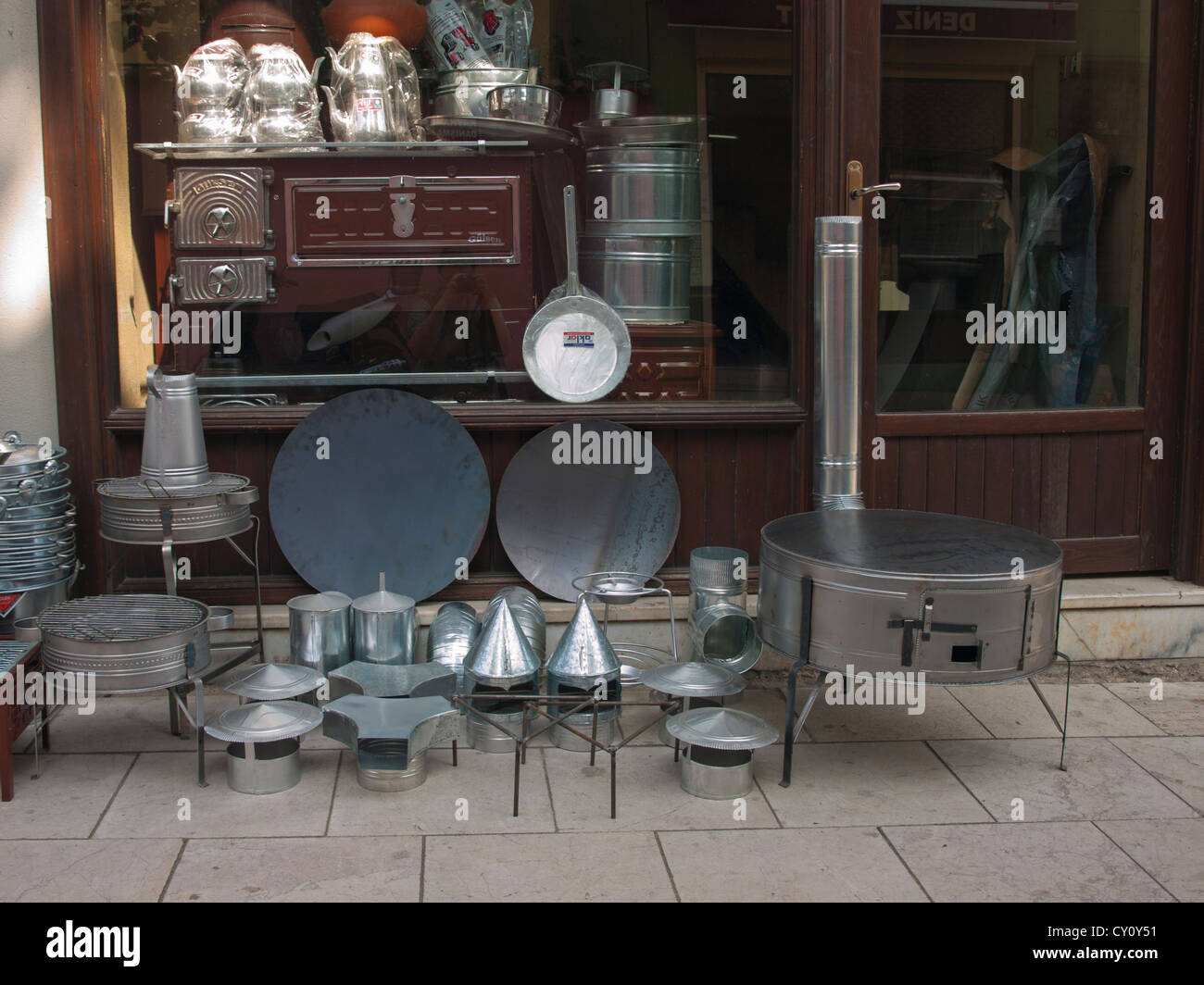 Portable stove and kitchen utensils outside of shop in market district of Bursa Turkey - Stock Image