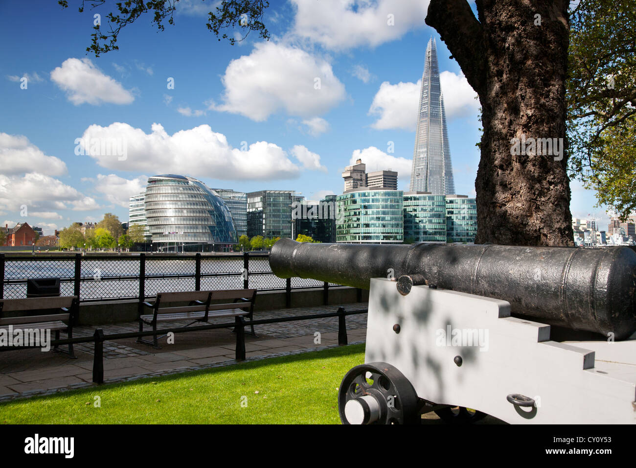 England. London. Cannon by the River Thames. City Hall and the Shard building in the background. - Stock Image