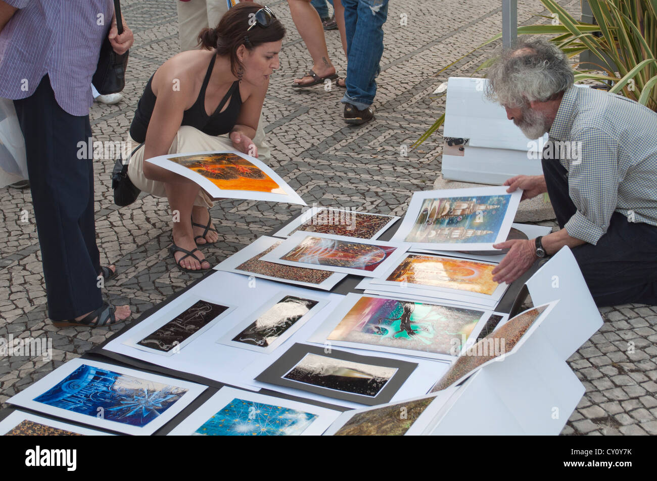 Man Selling Art Works On The Street In Lisbon Portugal
