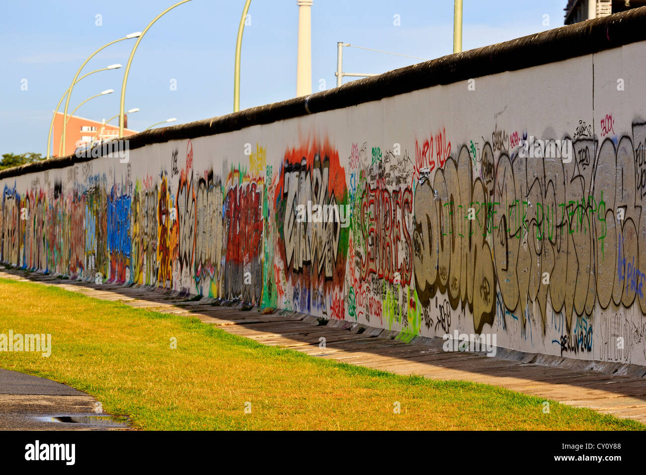Berlin Wall Berlin Germany colourful decorated Berlin Wall along the Spree River West Side of wall - Stock Image