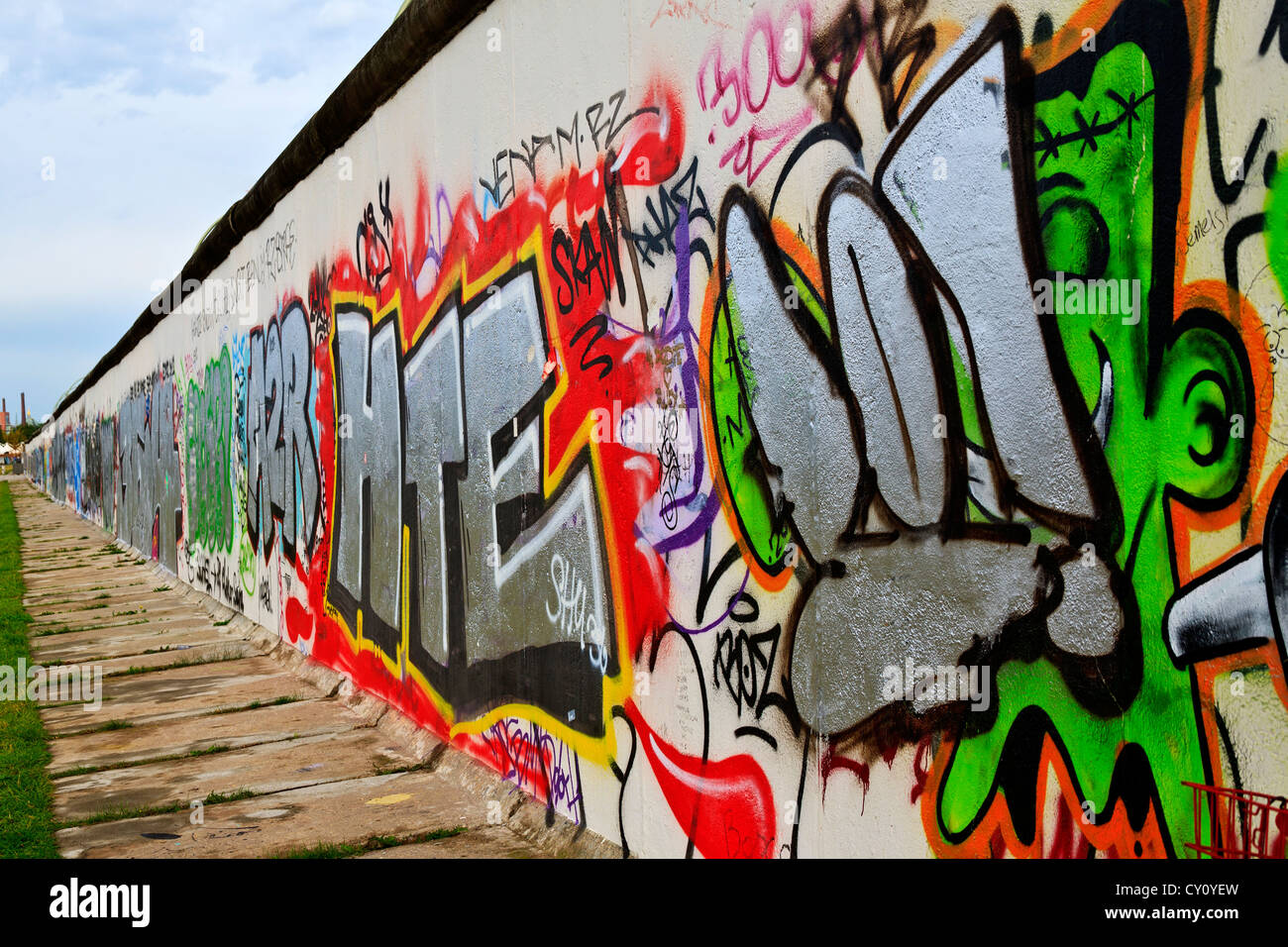 Berlin Wall Berlin Germany colorful decorated Berlin Wall along the Spree River West Side of wall - Stock Image