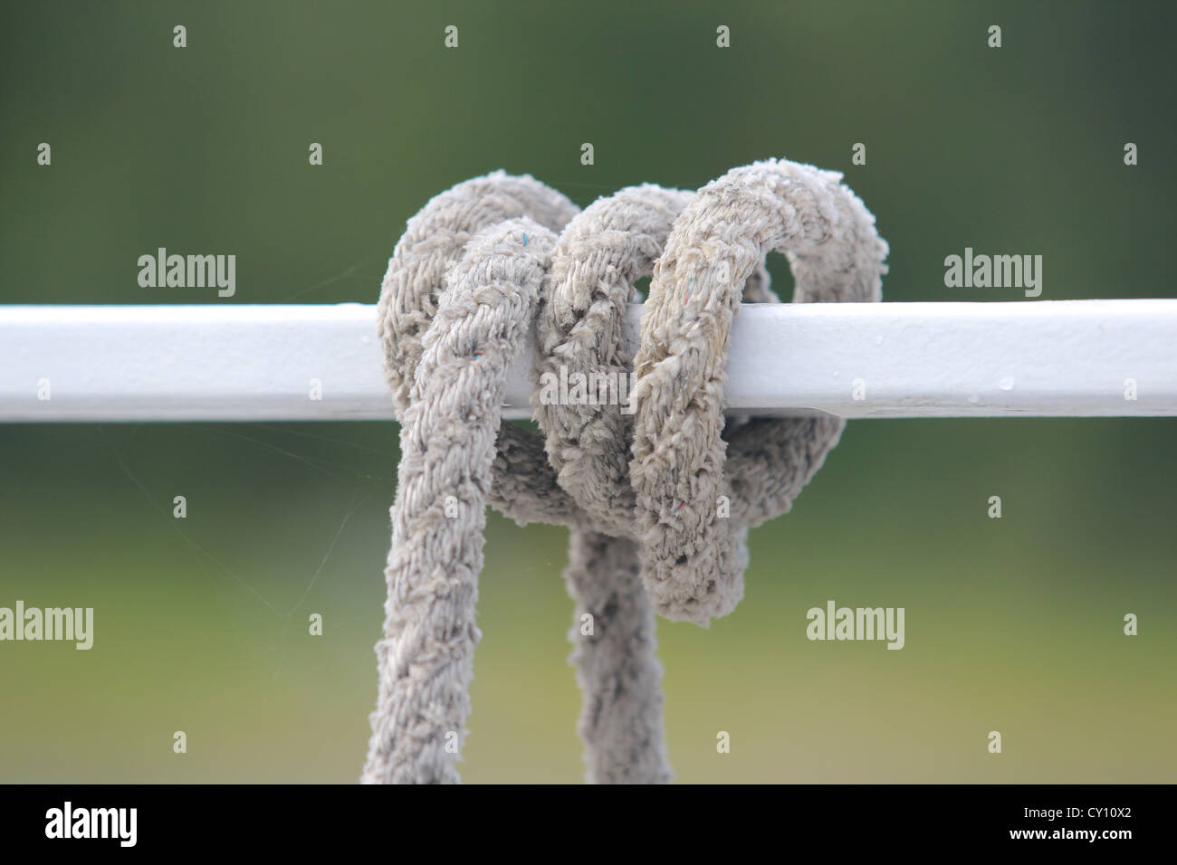 White rope coiled around a bar Stock Photo