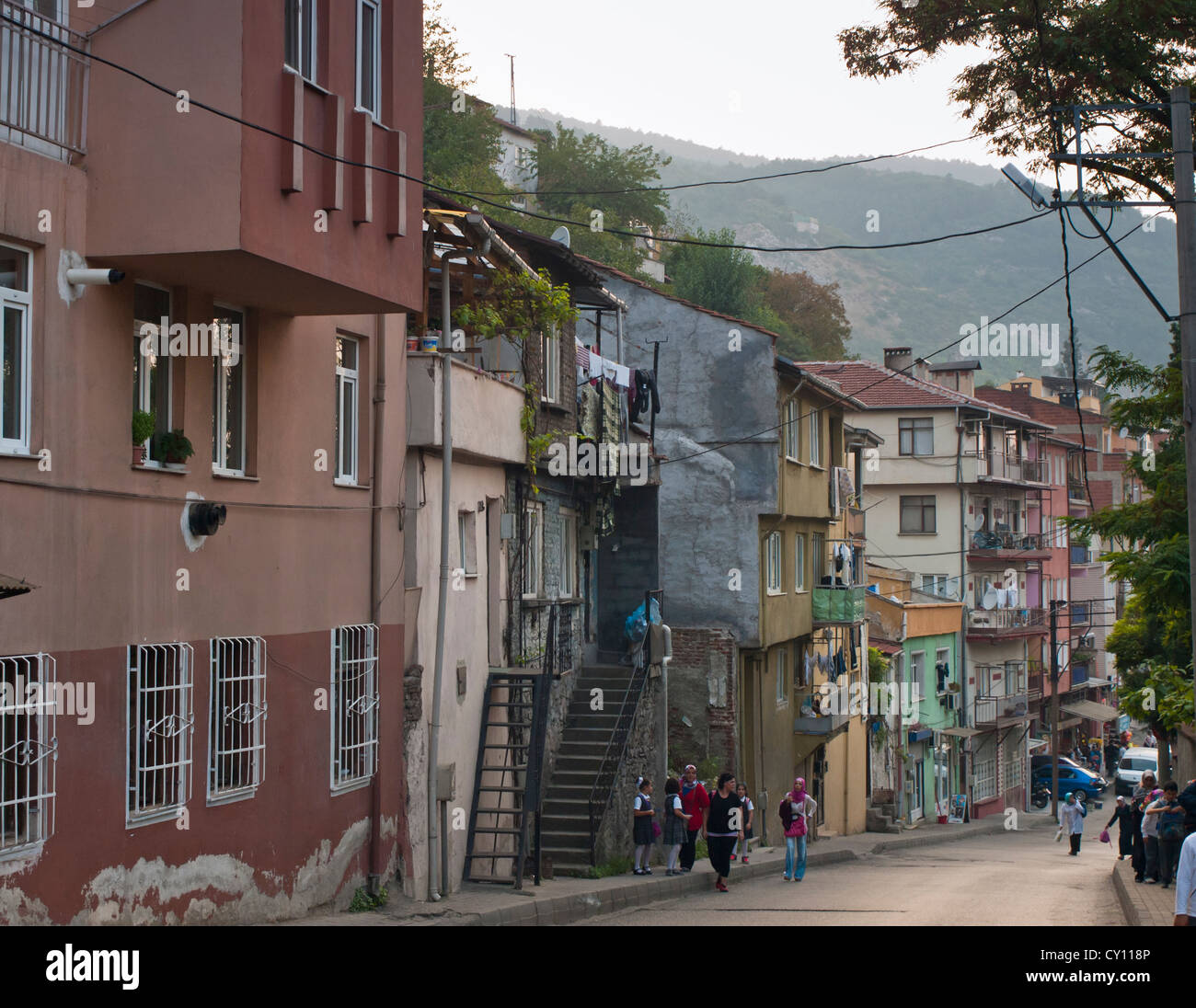 Streets in the Tophane district of Bursa Turkey, schoolchildren on the way home - Stock Image
