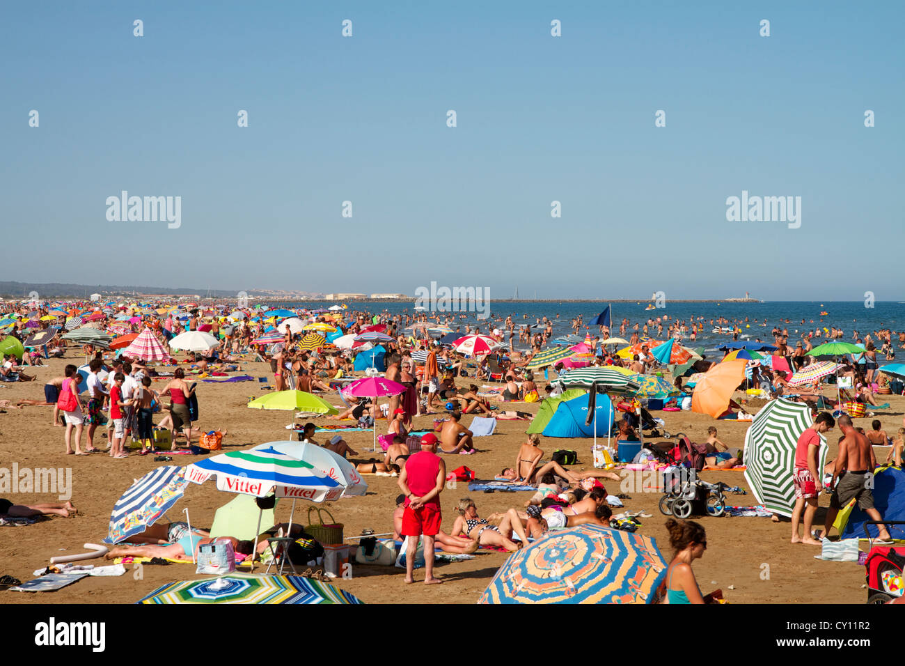 Gruissan Plage beach on a busy Summers day in Southern France - Stock Image