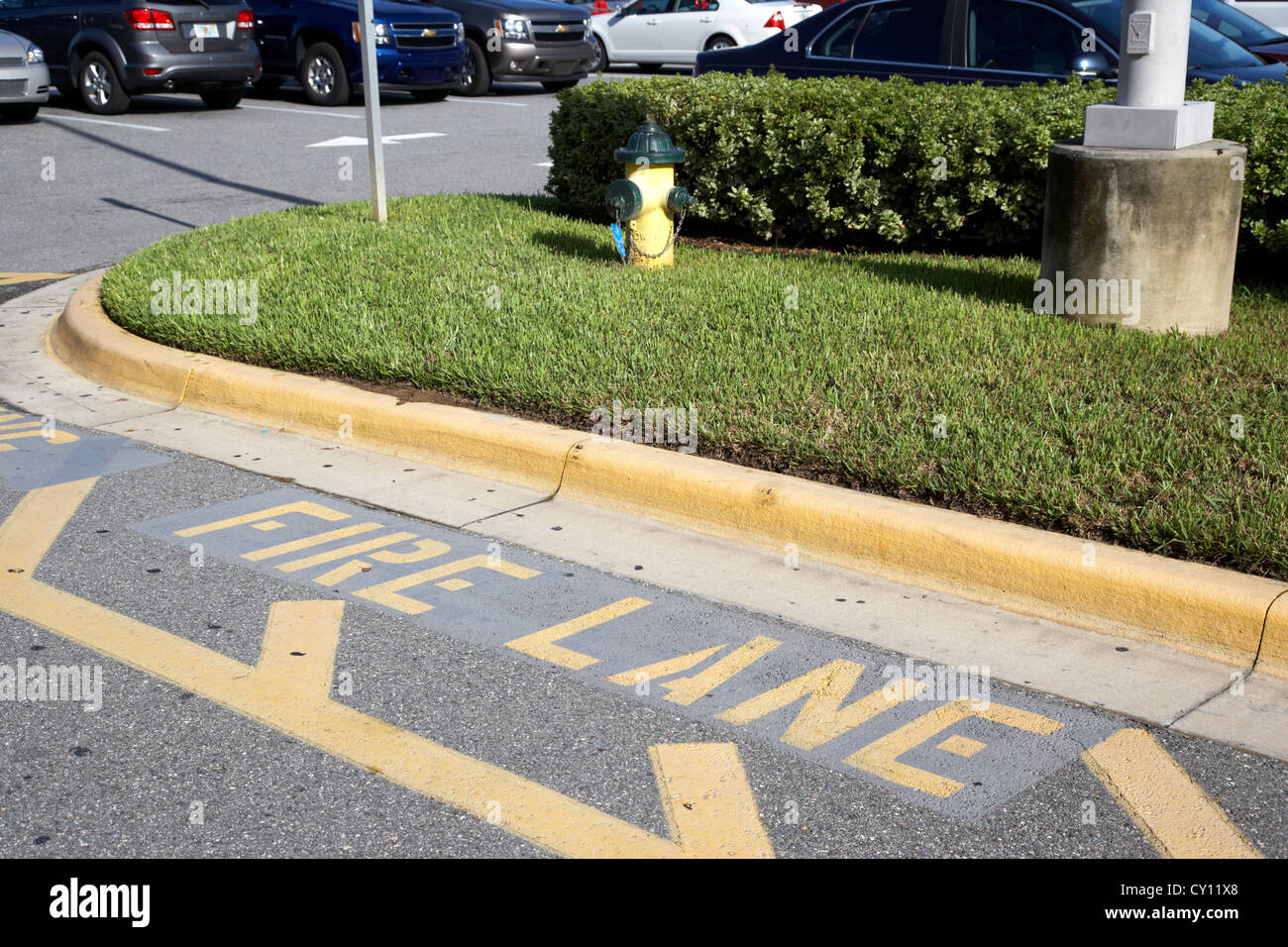 fire lane marking beside fire hydrant in car park orlando florida usa - Stock Image