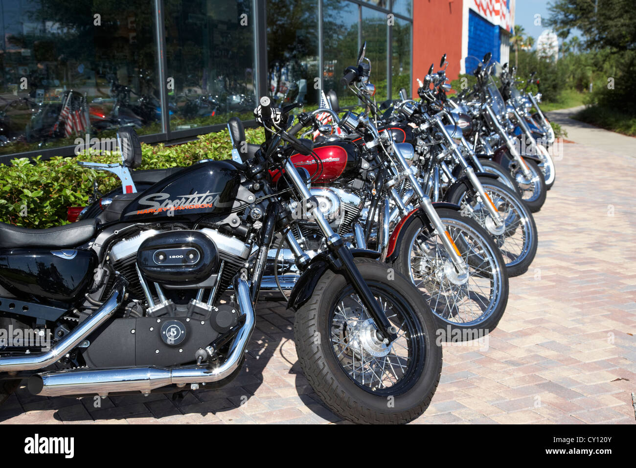 row of harley davidson motorbikes including sportster outside motorcycle dealership orlando florida usa - Stock Image