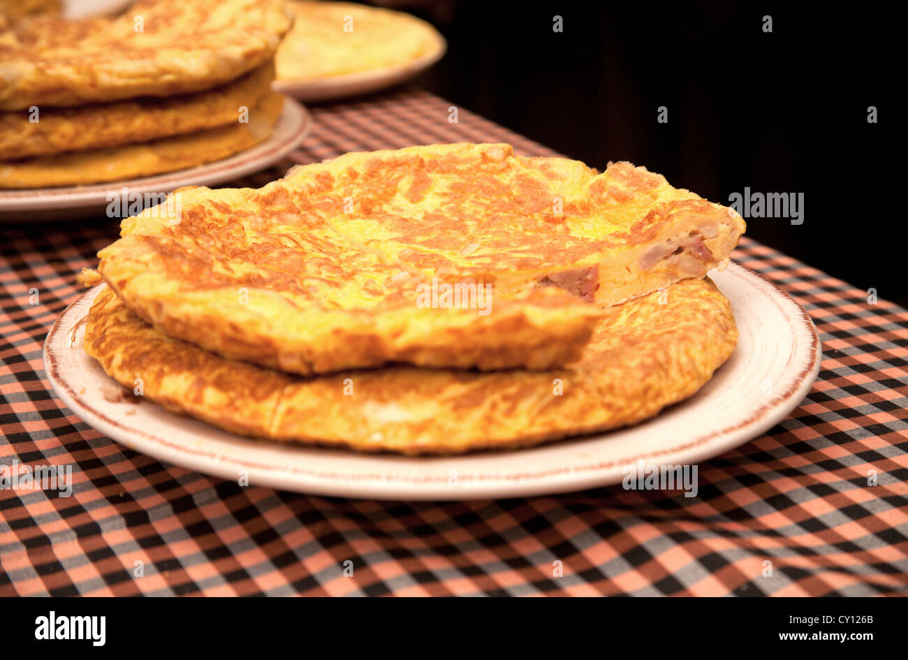 Fresh tortilla (omelet with eggs, potatoes, onion and ham), a typical Spanish food. - Stock Image