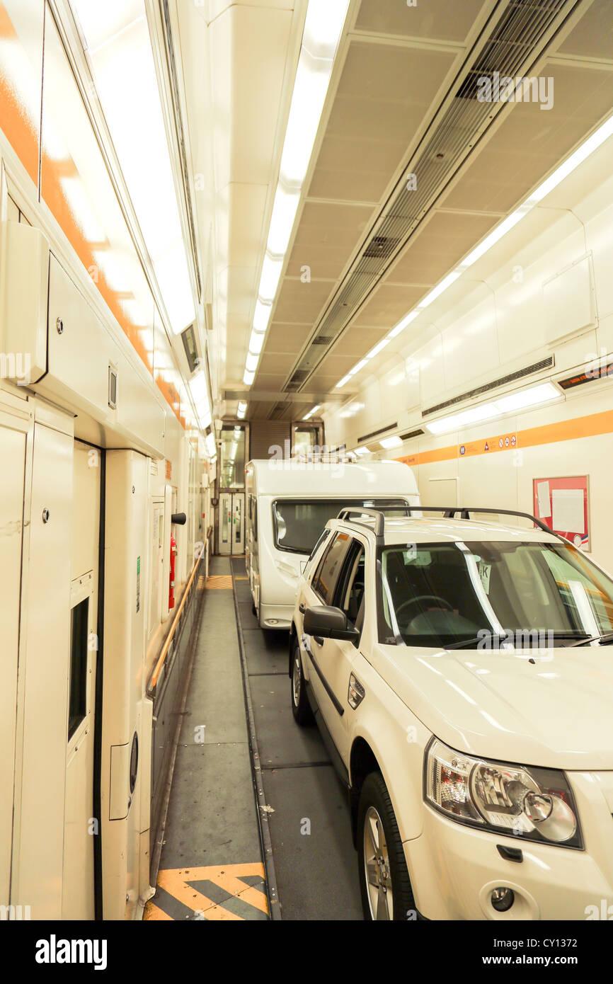A Car And Trailer Caravan Inside A Train Carriage Of A Eurotunnel Le