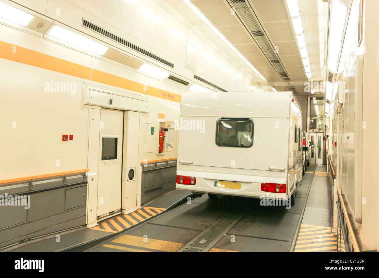 A Car And Trailer Caravan Inside A Train Carriage Of A Eurotunnel Le