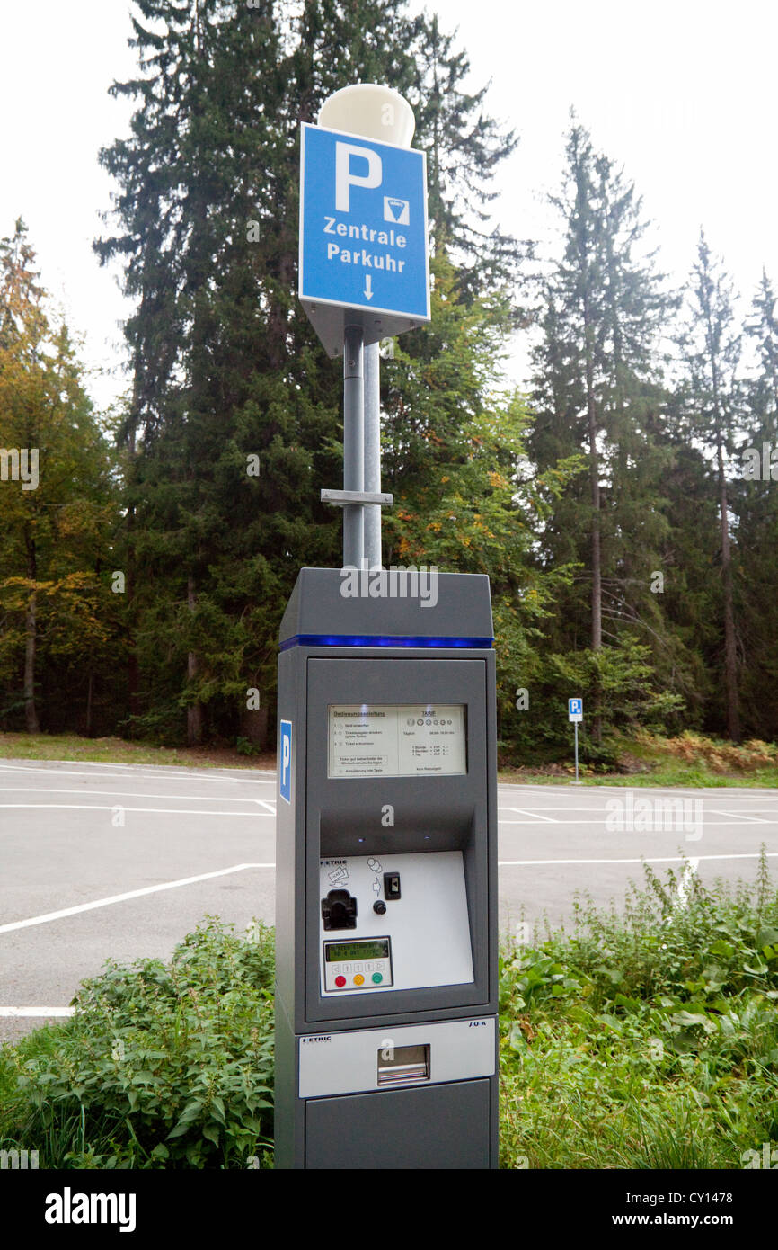 Pay and display car parking meter in a car park, Switzerland, Europe - Stock Image