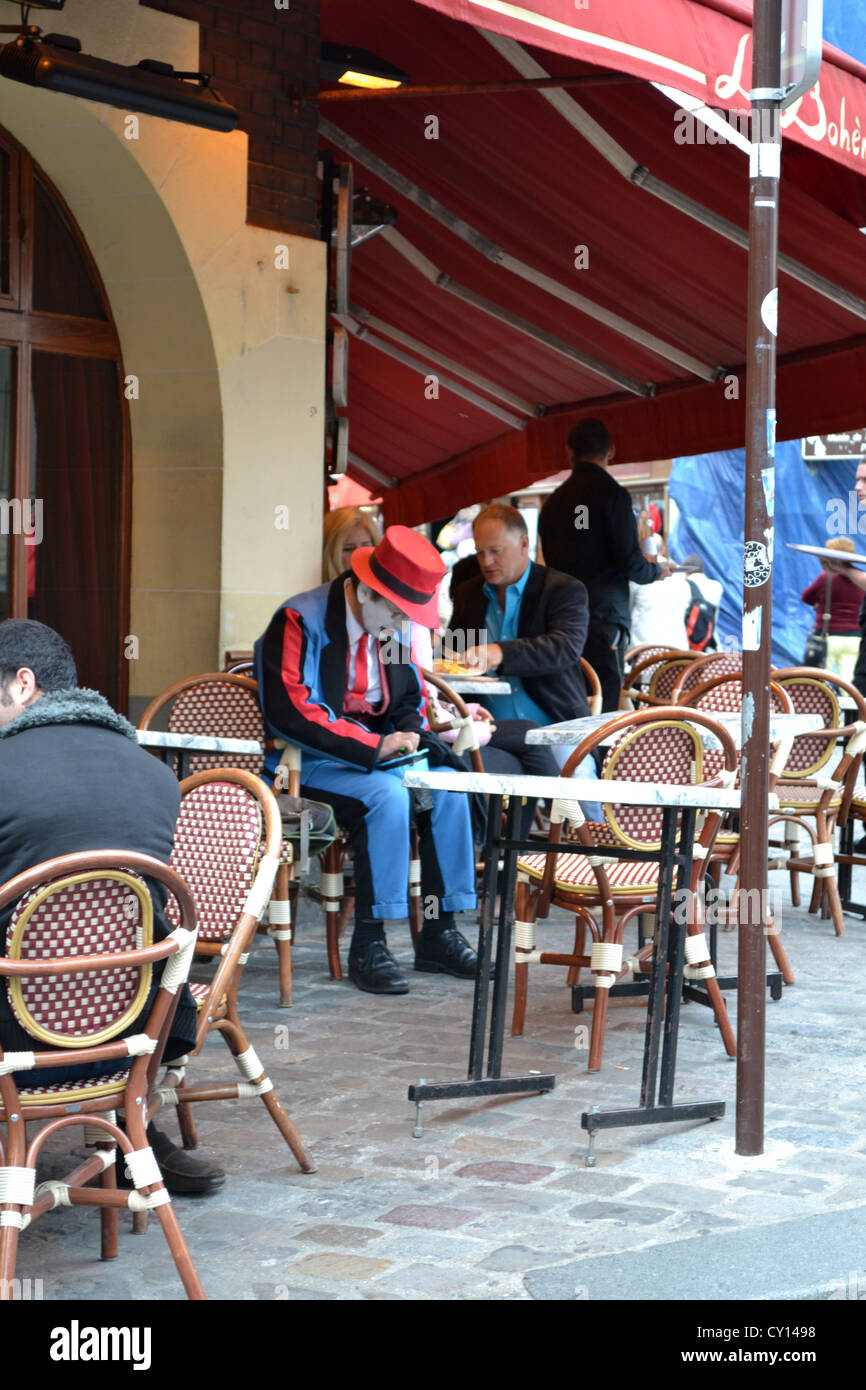 Mime street artist having a break in a Paris cafe by the Sacre Coeur, Paris, France. - Stock Image