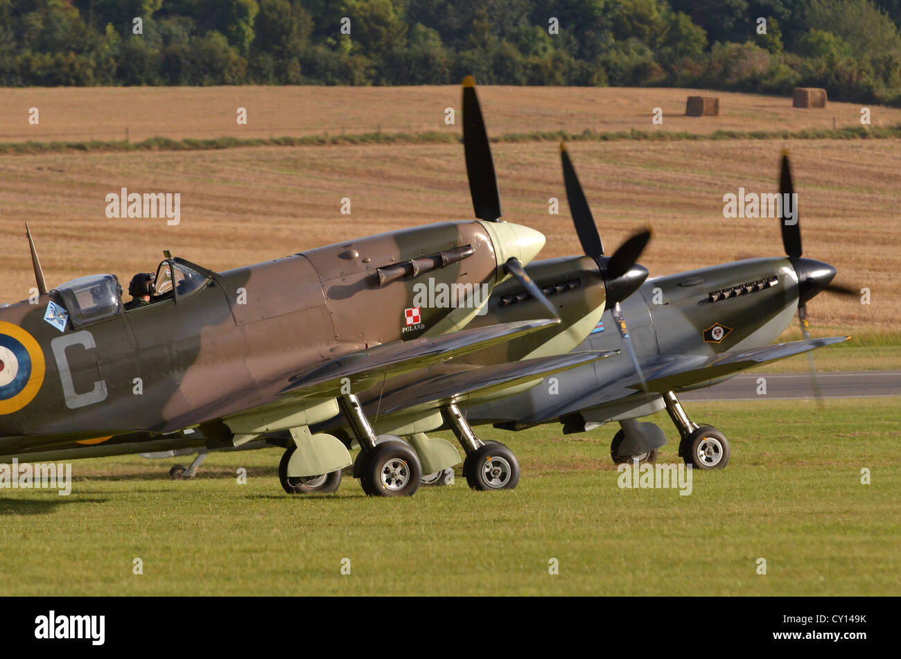 Supermarine Spitfire plane trio in RAF colours ready for take-off, Duxford Airshow, UK. L to R: Spitfire Mk. Vb, - Stock Image