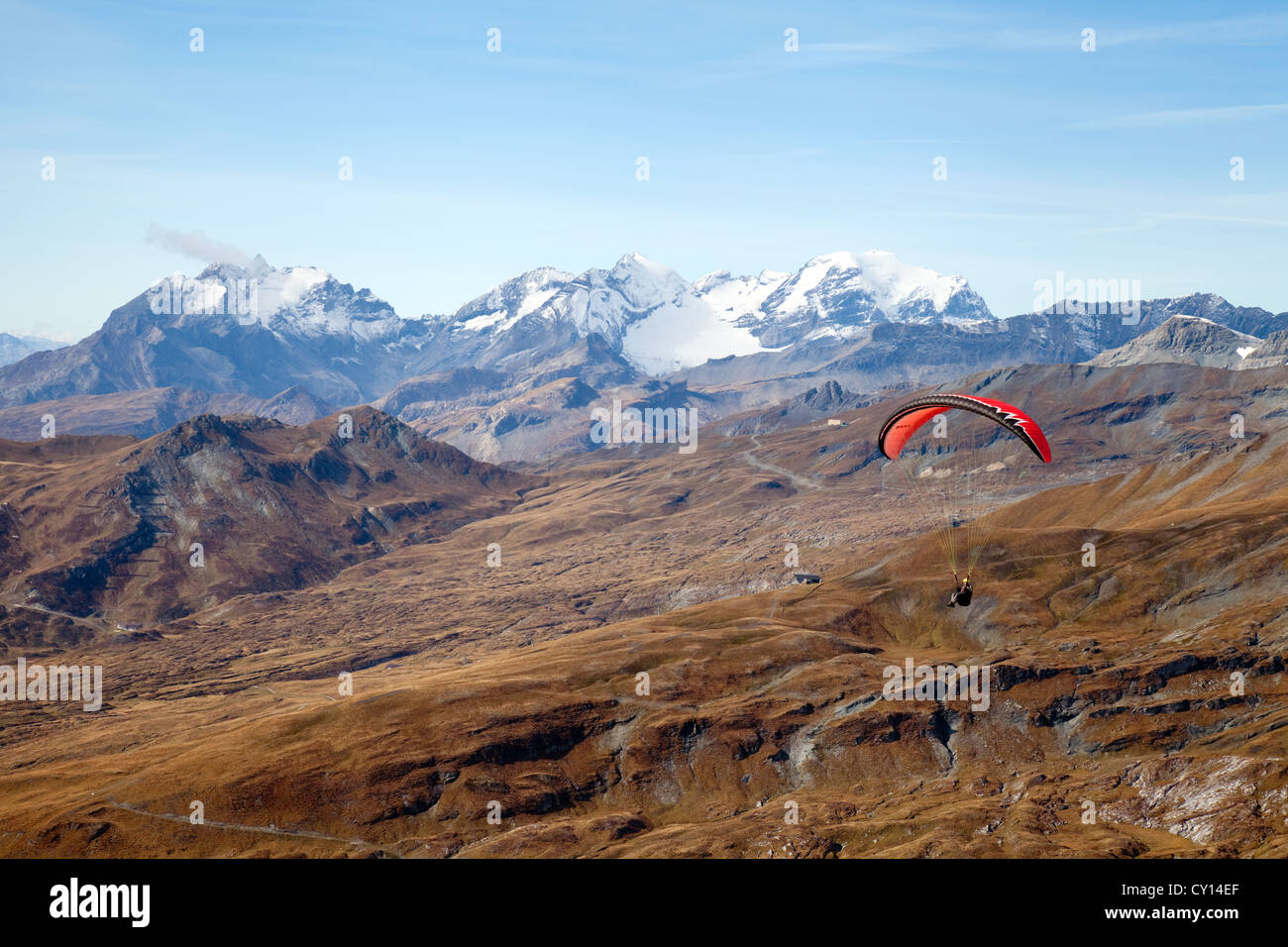 A paraglider paragliding, the Swiss Alps, Switzerland europe Stock Photo