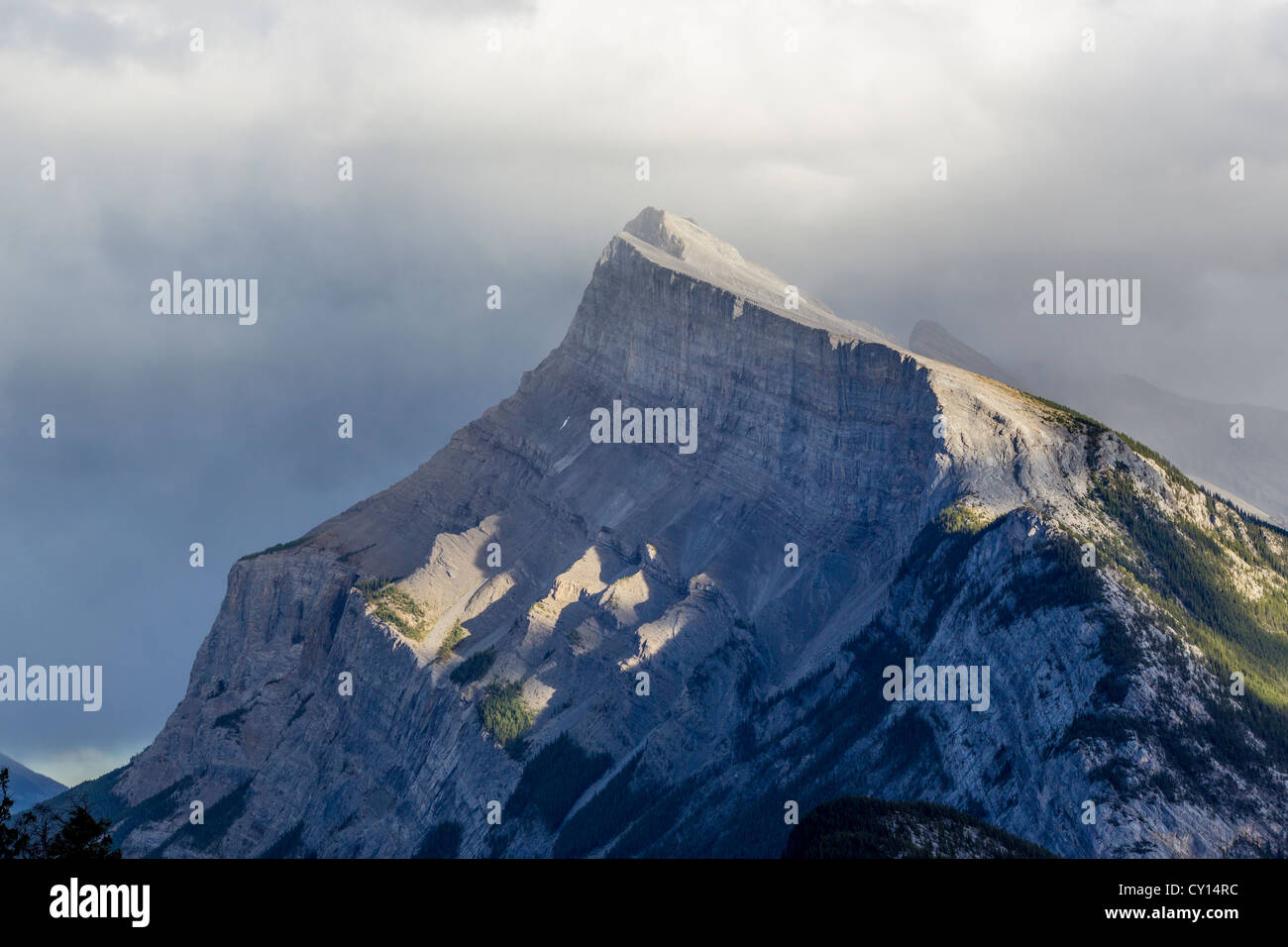 Mount Rundle is formed of outcrops of massive limestones in Banff National Park in Alberta Canada - Stock Image