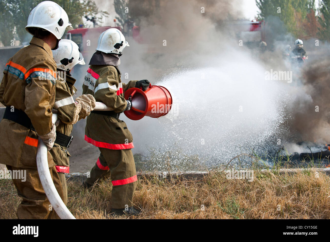 Kyrgyz Republic firefighters extinguish a controlled fire during a demonstration at the Transit Center at Manas, - Stock Image