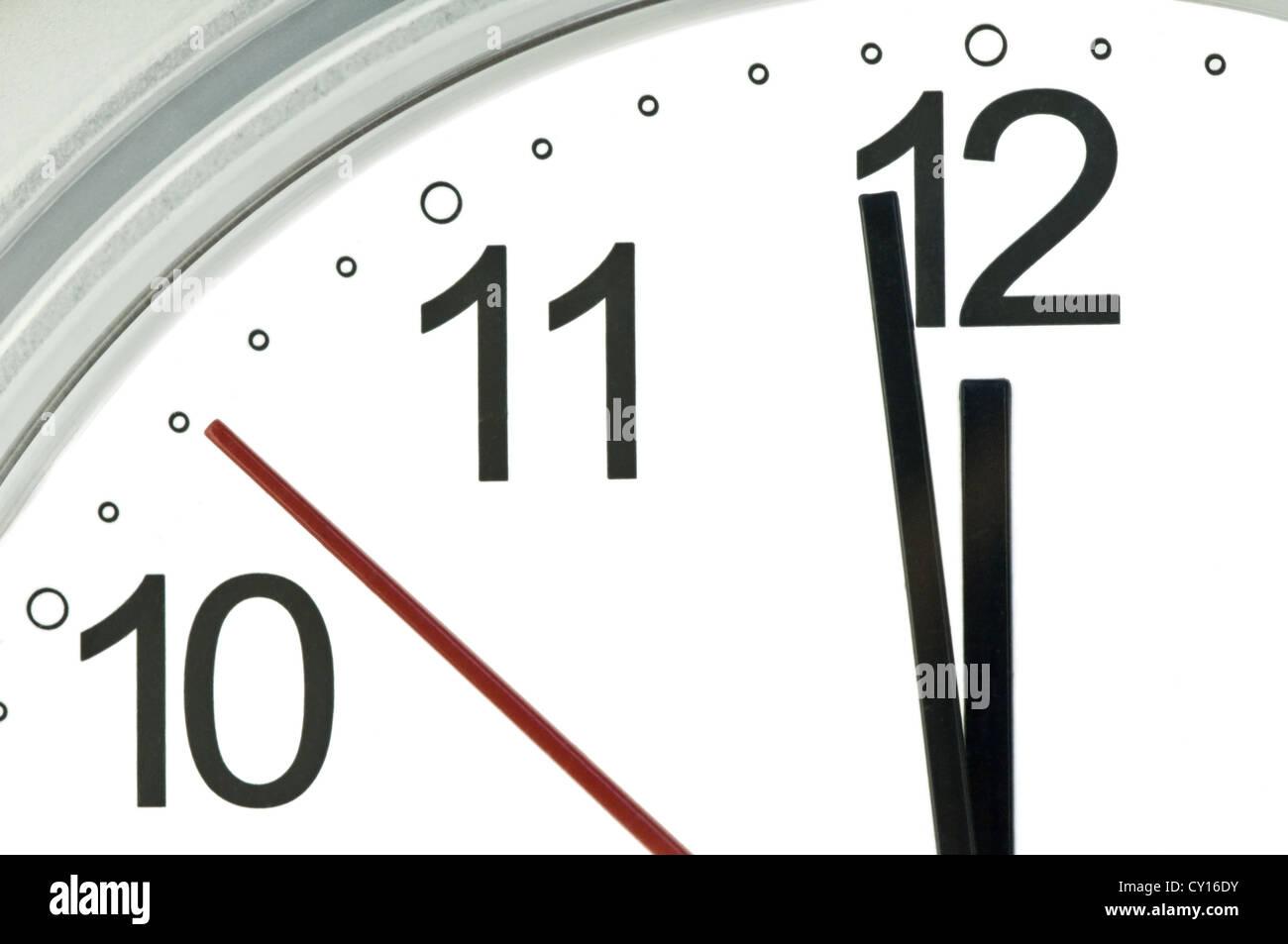 clock hands indicate almost twelve - Stock Image