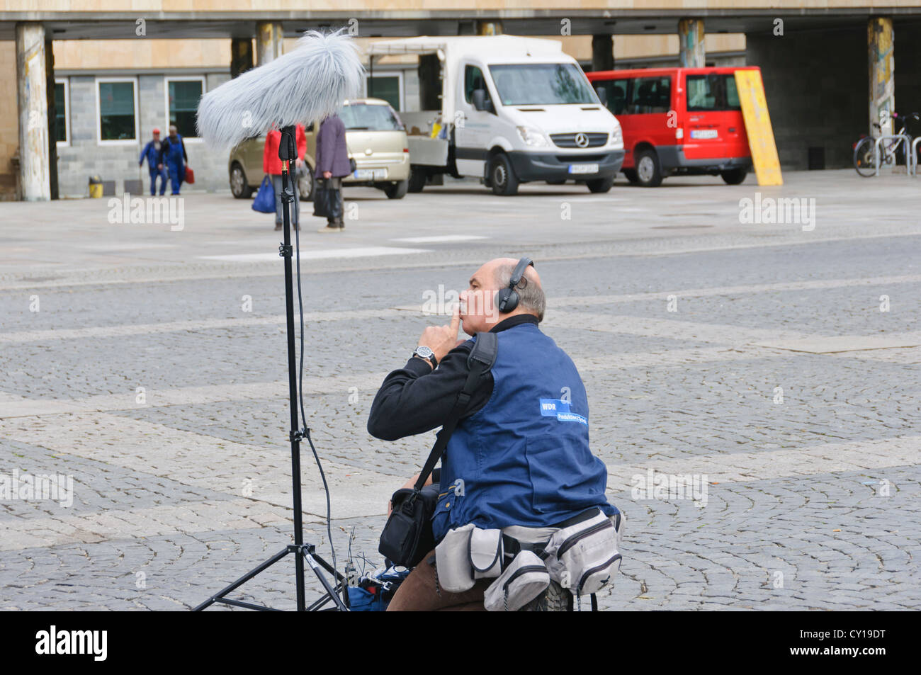 "Sound engineer from the German public television station broadcaster WDR with microphone on stand and ""dead cat"" - Stock Image"