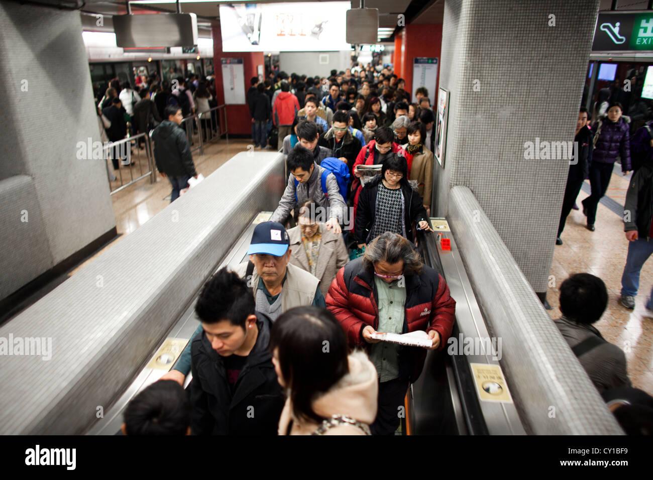 escalator to underground in Hongkong - Stock Image