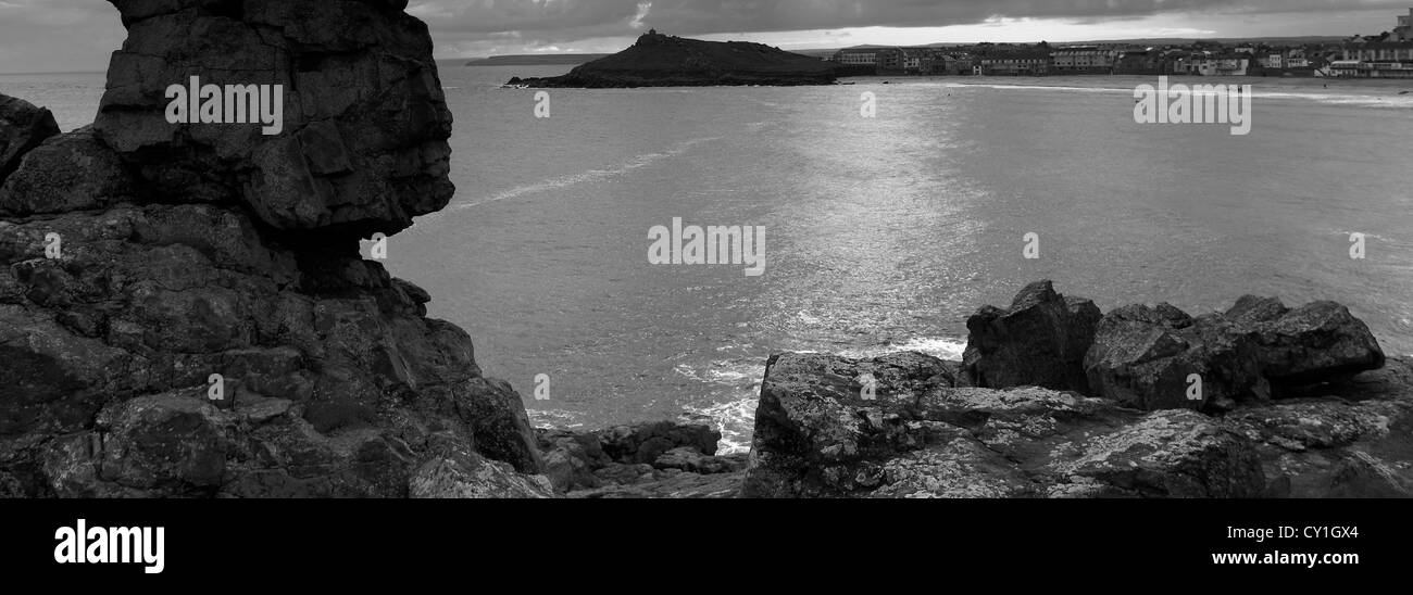 Black and white panoramic image rocks on clodgy point porthmeor beach st ives cornwall county england uk