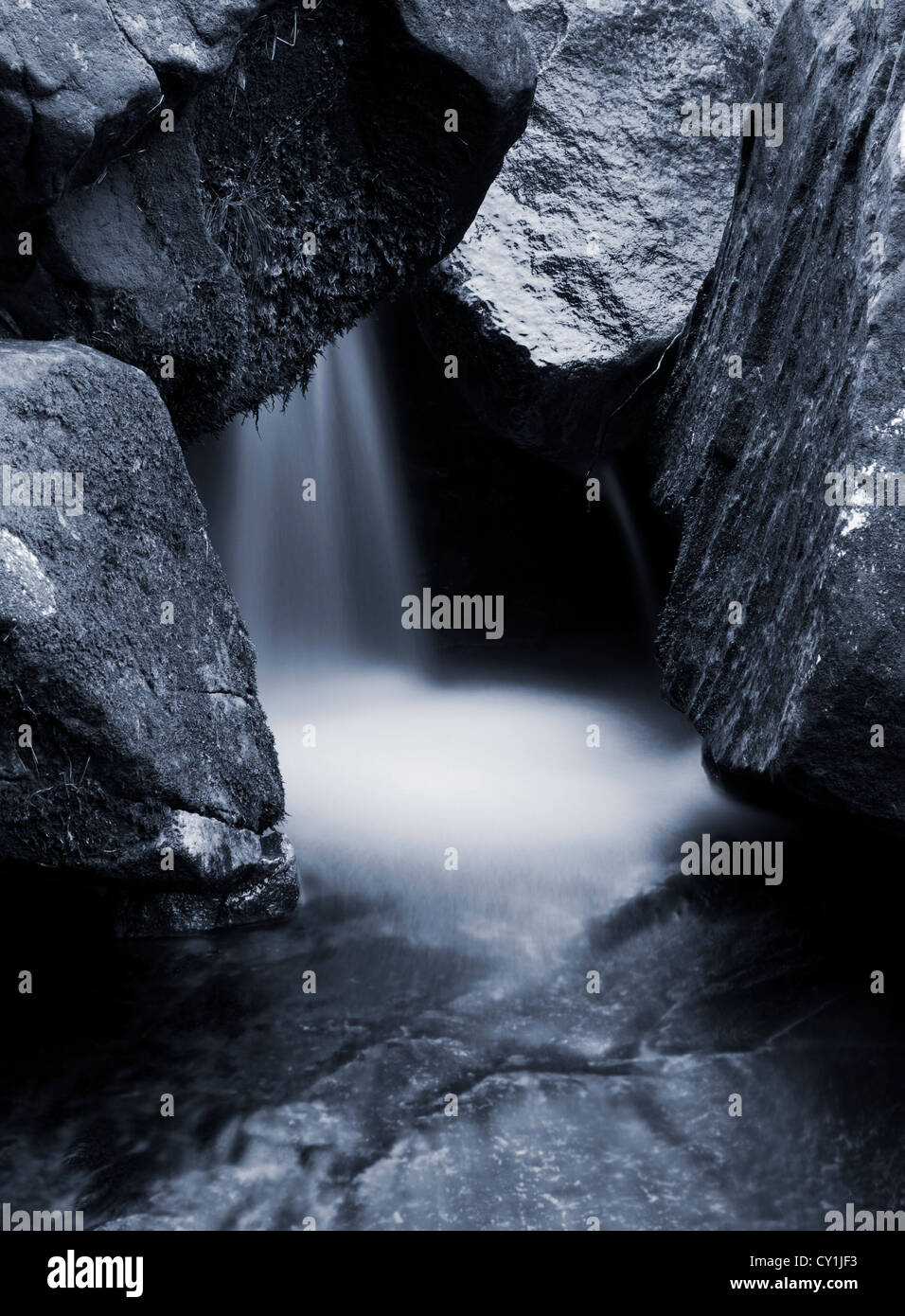 Waterfall with large boulders - Stock Image