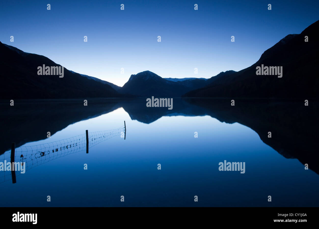 Reflections of mountains in a lake at Buttermere, Lake District, Cumbria, England - Stock Image